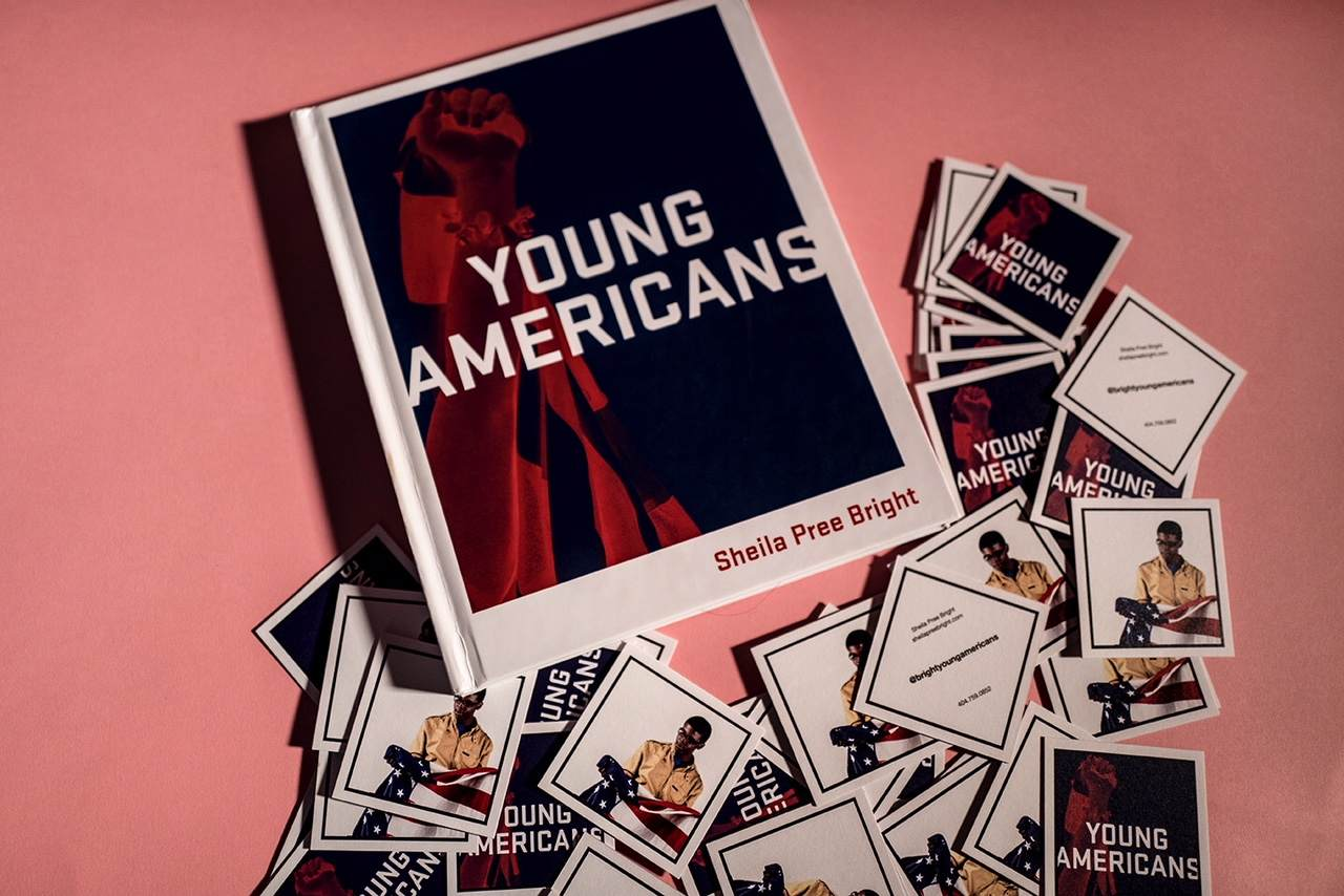 Above view of the Young Americans book cover and square Young Americans branded info cards surround the book.