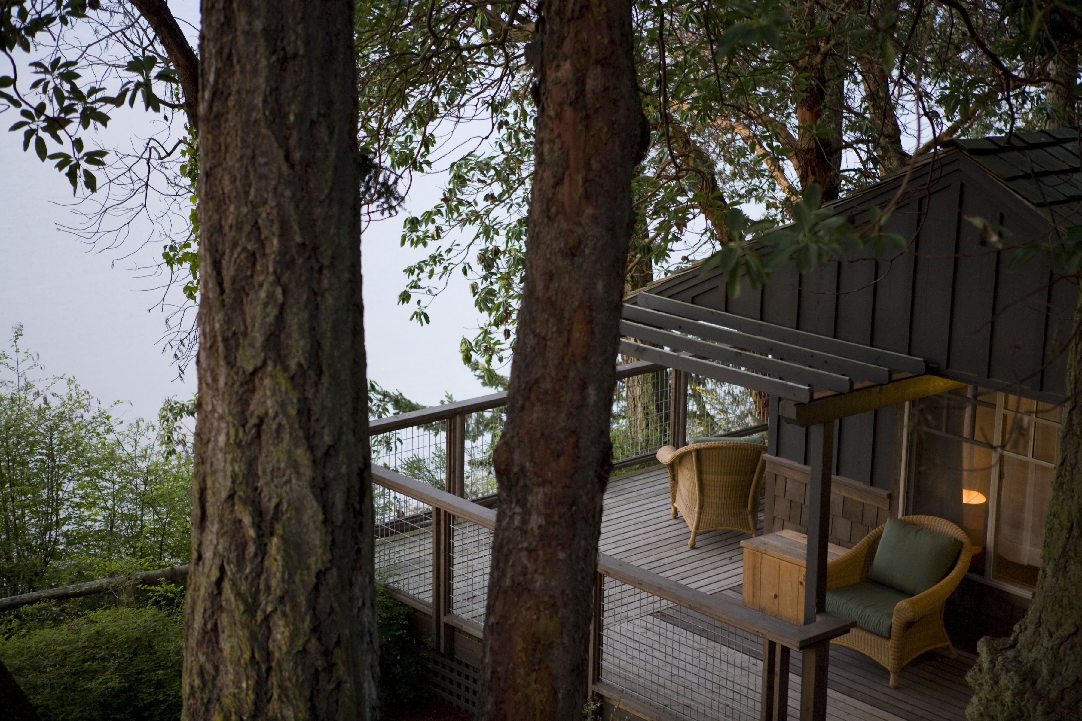 A cabin and deck at Captain Whidbey Inn | Cabin rentals Washington.