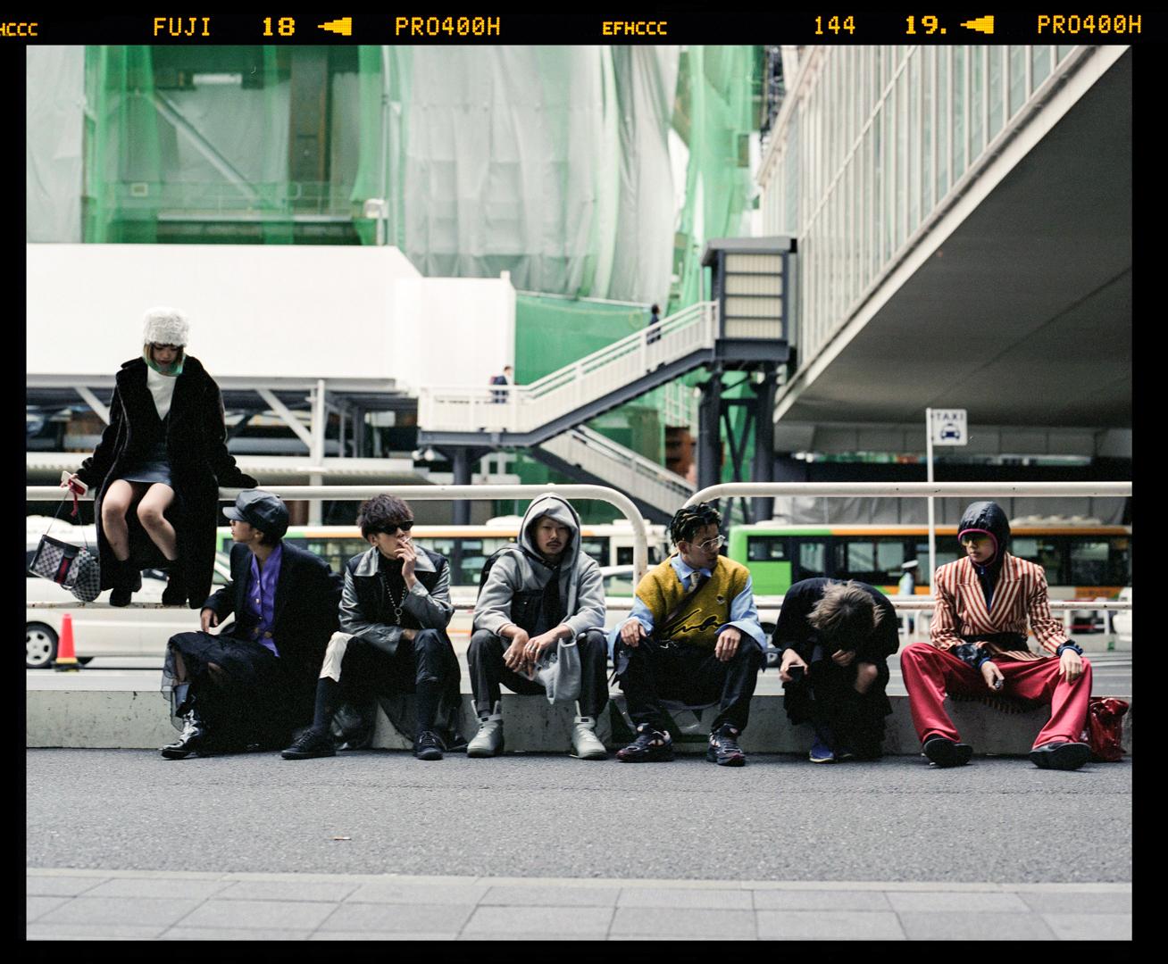 Group of young Japanese enjoying the fashion week in Shibuya