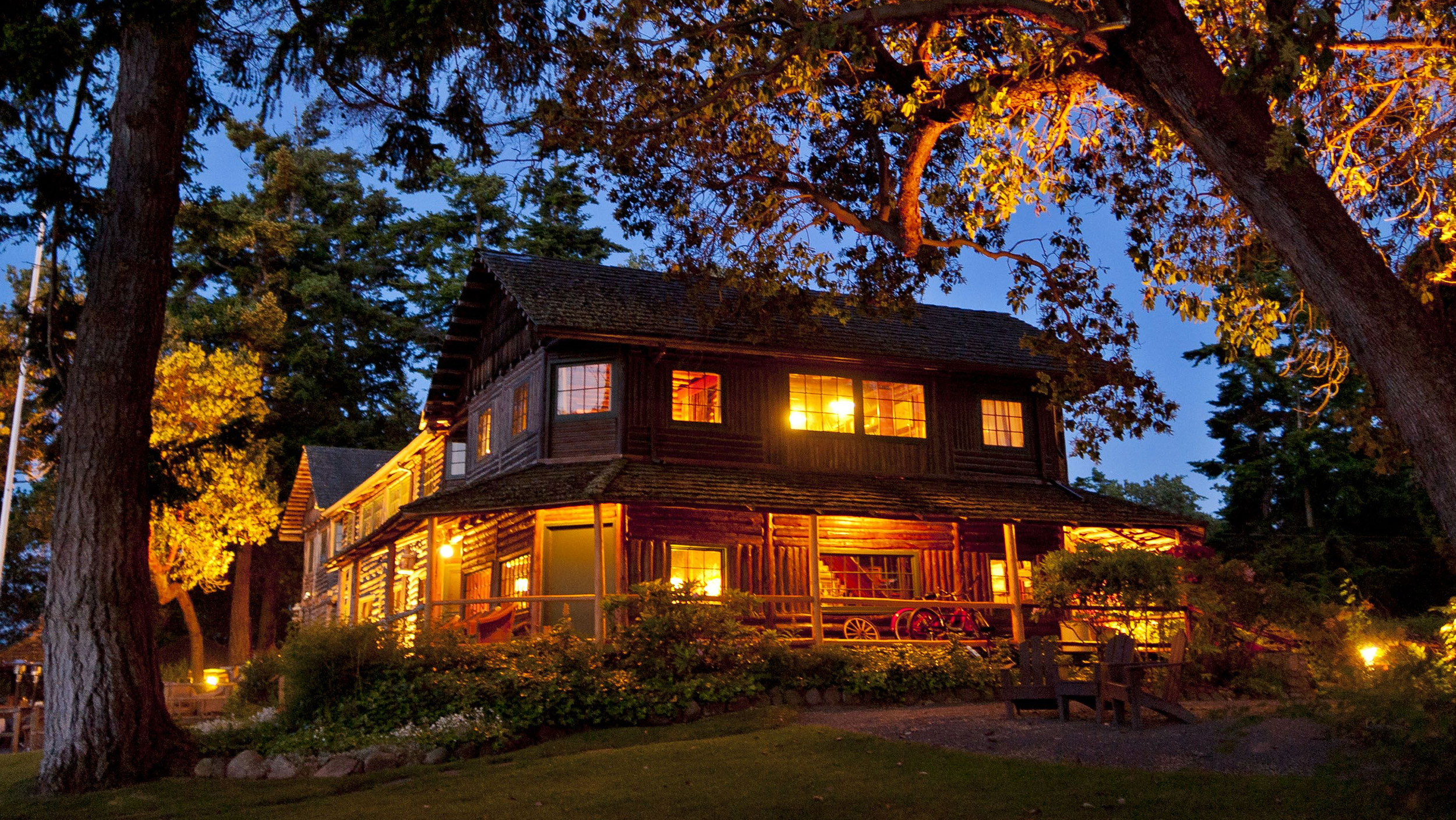 The Captain Whidbey Inn lodge at night. Pacific Northwest cabin rentals and one of the best lodges in Washington State.