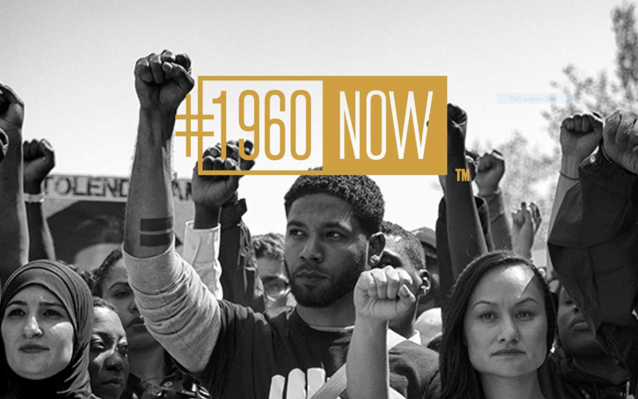 Black and white protest image by Sheila Pree Bright with the #1960Now gold logo.