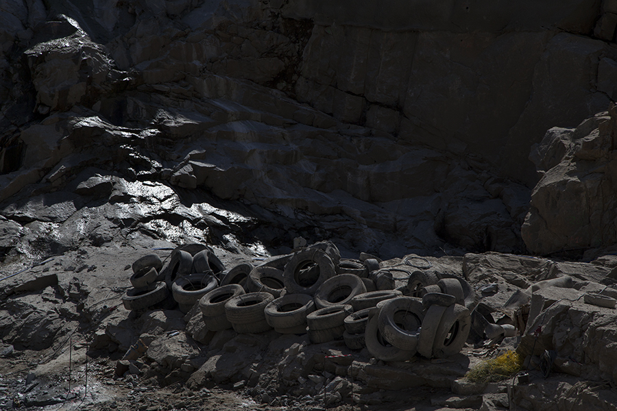 carina martins, untitled - tires and river close to a dam being builded