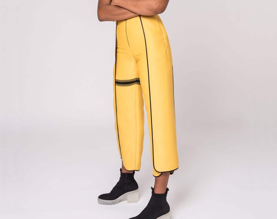 front view of yellow split seam pants