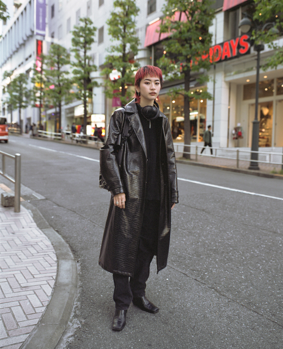 Nanami wearing a vintage leather jacket in  Shibuya