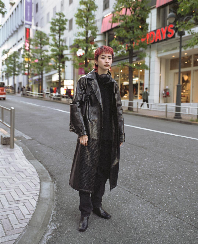 Nanami wearing a vintage leather jacket in  Shibuya