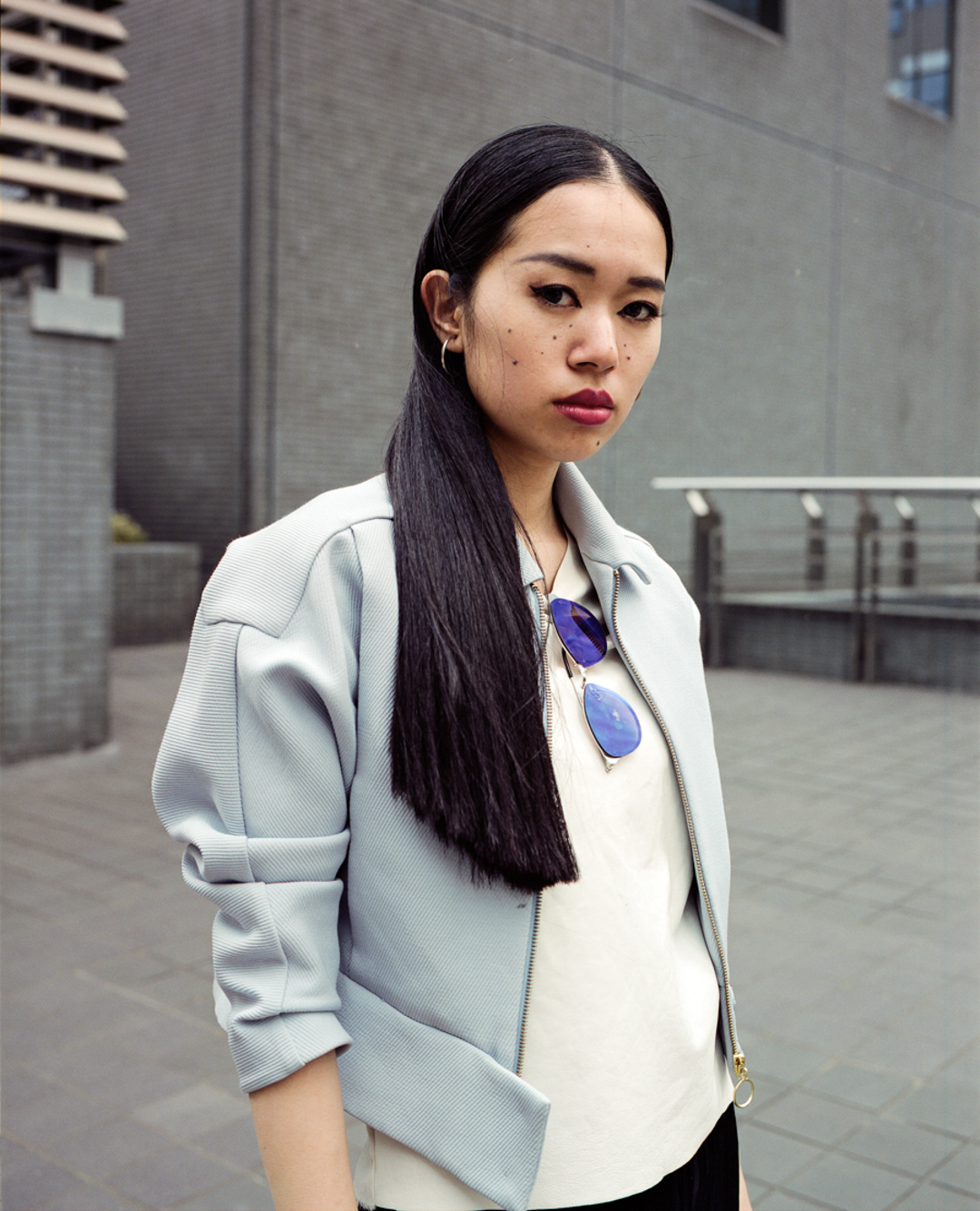 Momo wearing a blue pastel designer jacket in Shinjuku