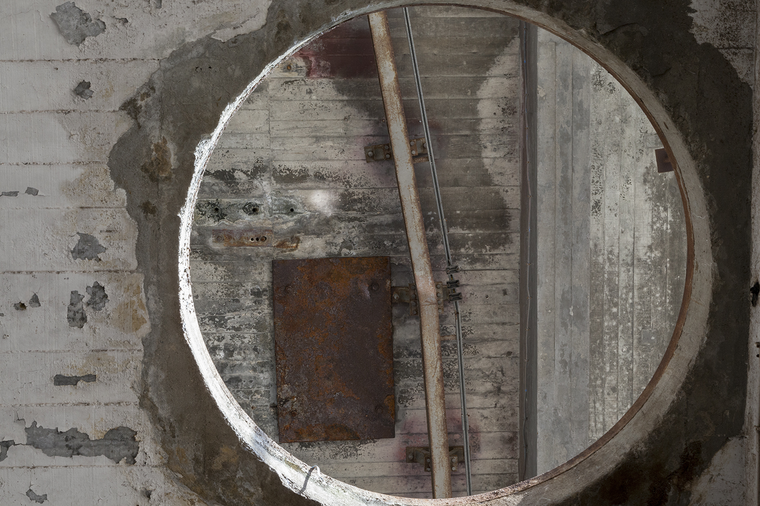 carina martins, vertical ascent - circular opening in the roof in an abandoned factory