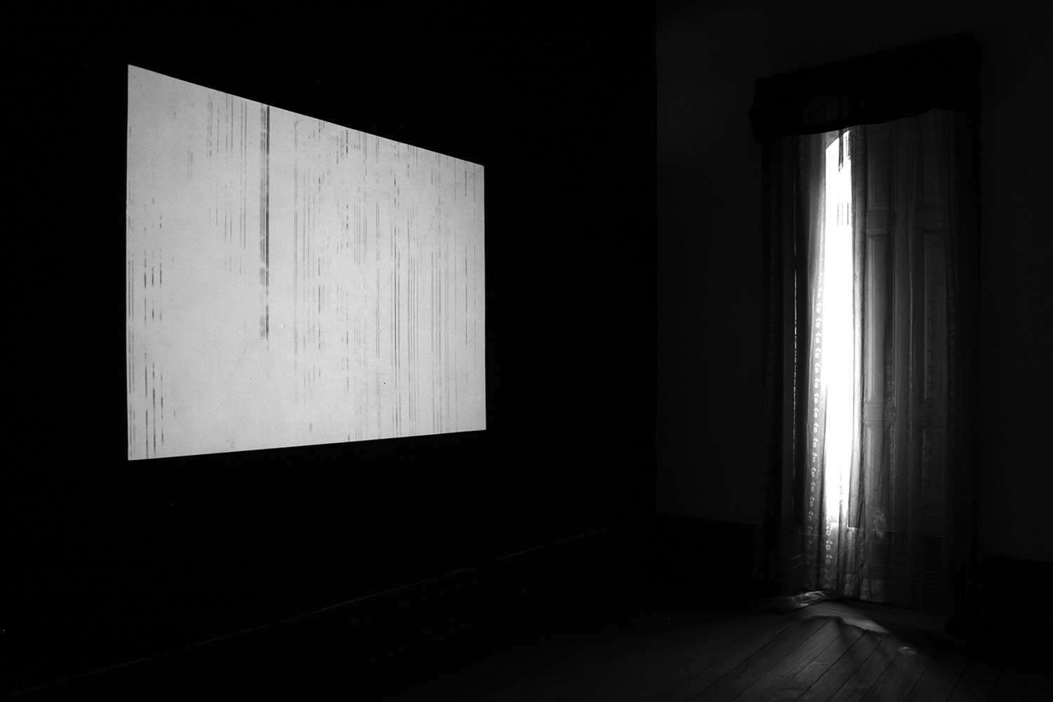 carina martins, asyncho - audiovisual projection in a black wall with window