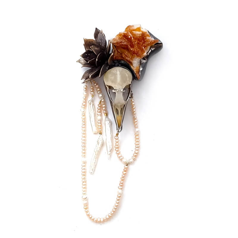Sempur brooch with european straling skull, freshwater pears, fine silver and cast bronze hen and chick by Anna Johnson