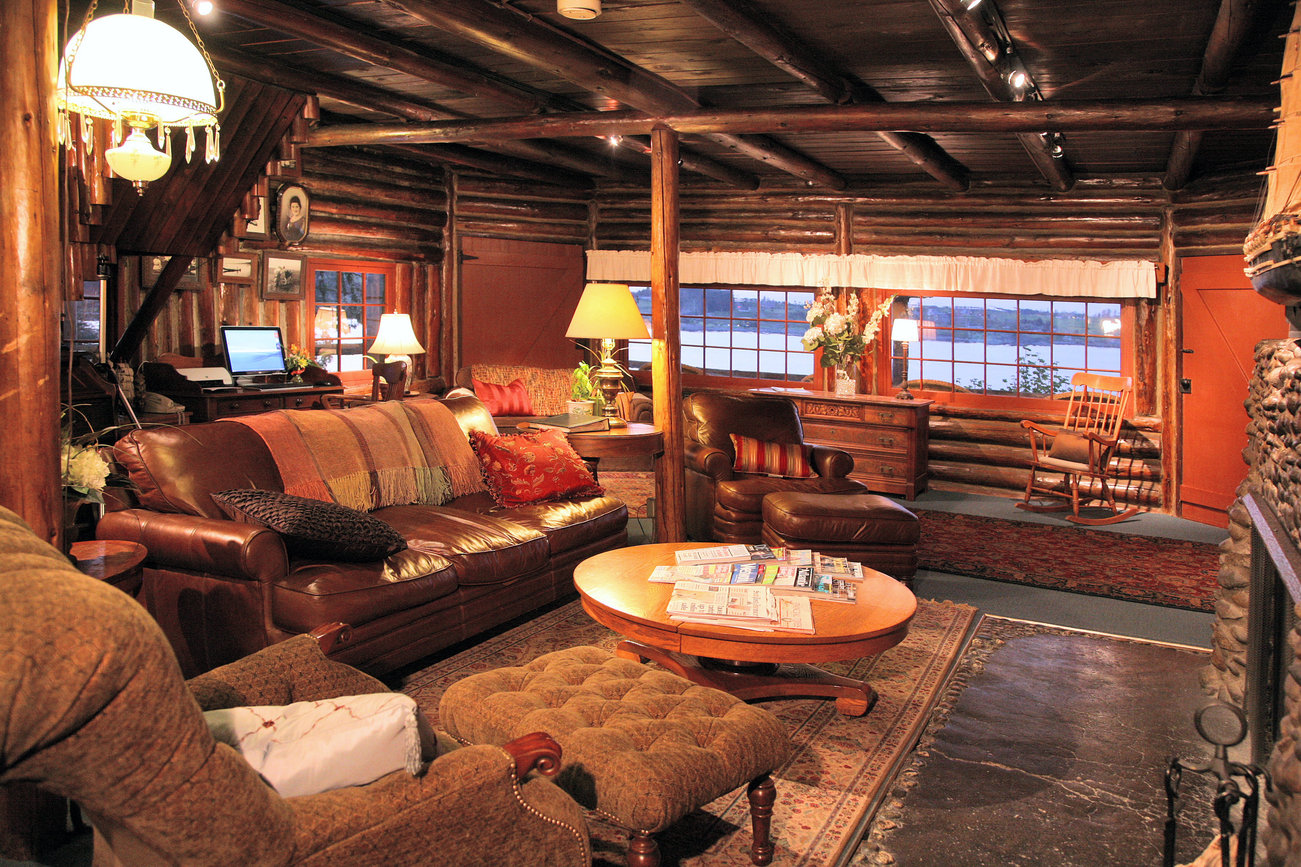 Cozy gathering room with stone fireplace in the lodge at Captain Whidbey Inn   Port Townsend WA Hotels.