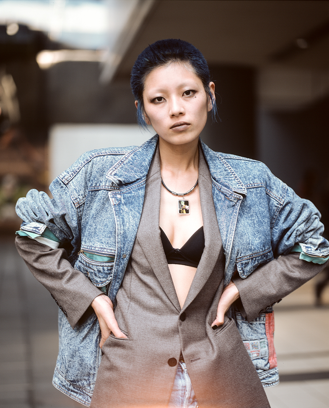 Yuna with a denim jacket over a suit jacket in Shibuya