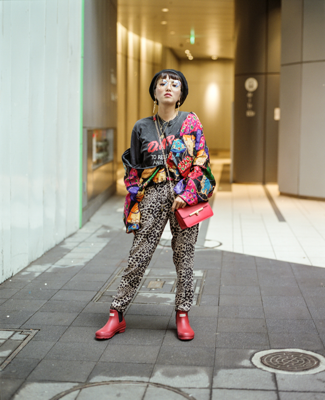 Young japanese girl daring colours and prints in Shibuya