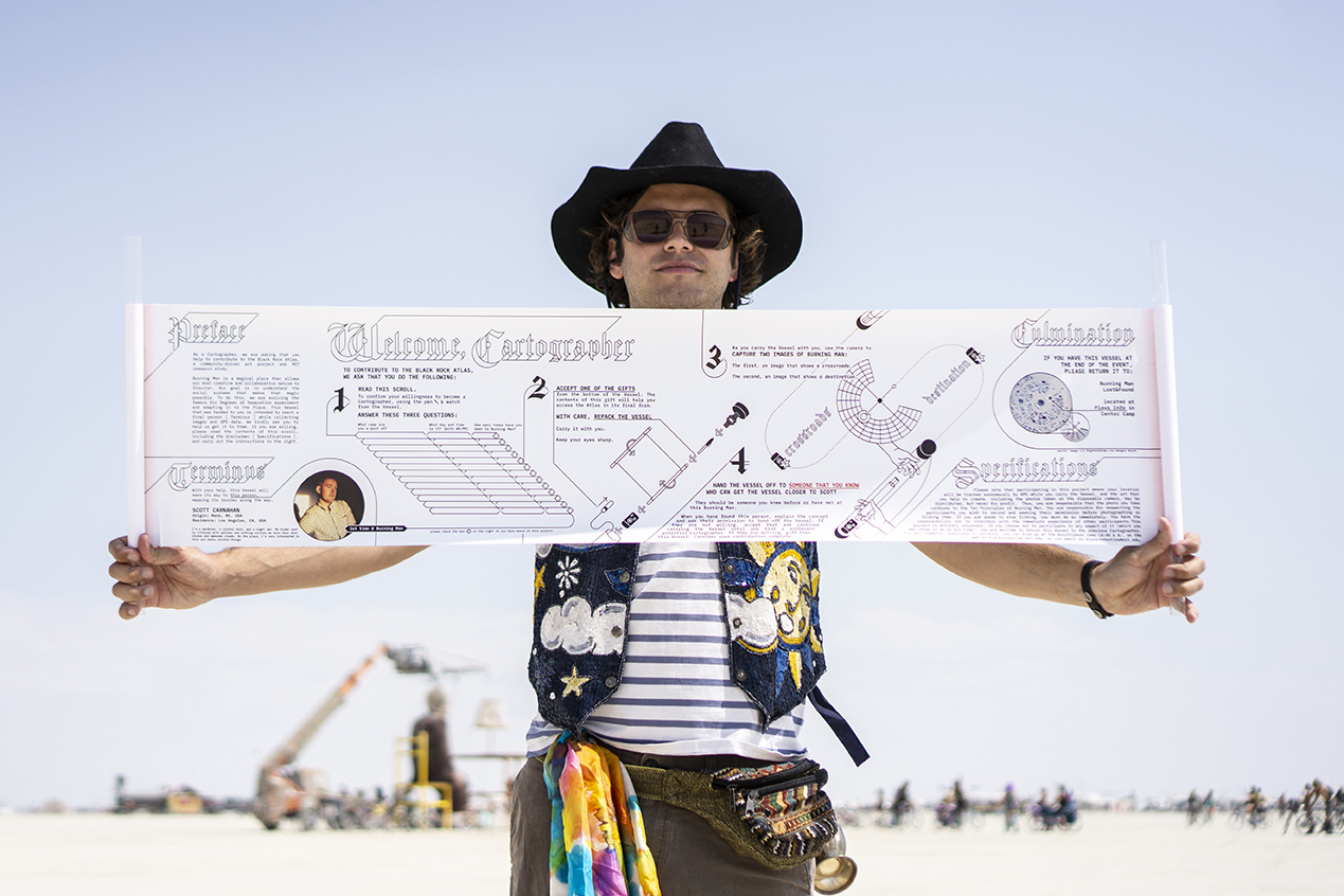 a person holding the scroll that I designed