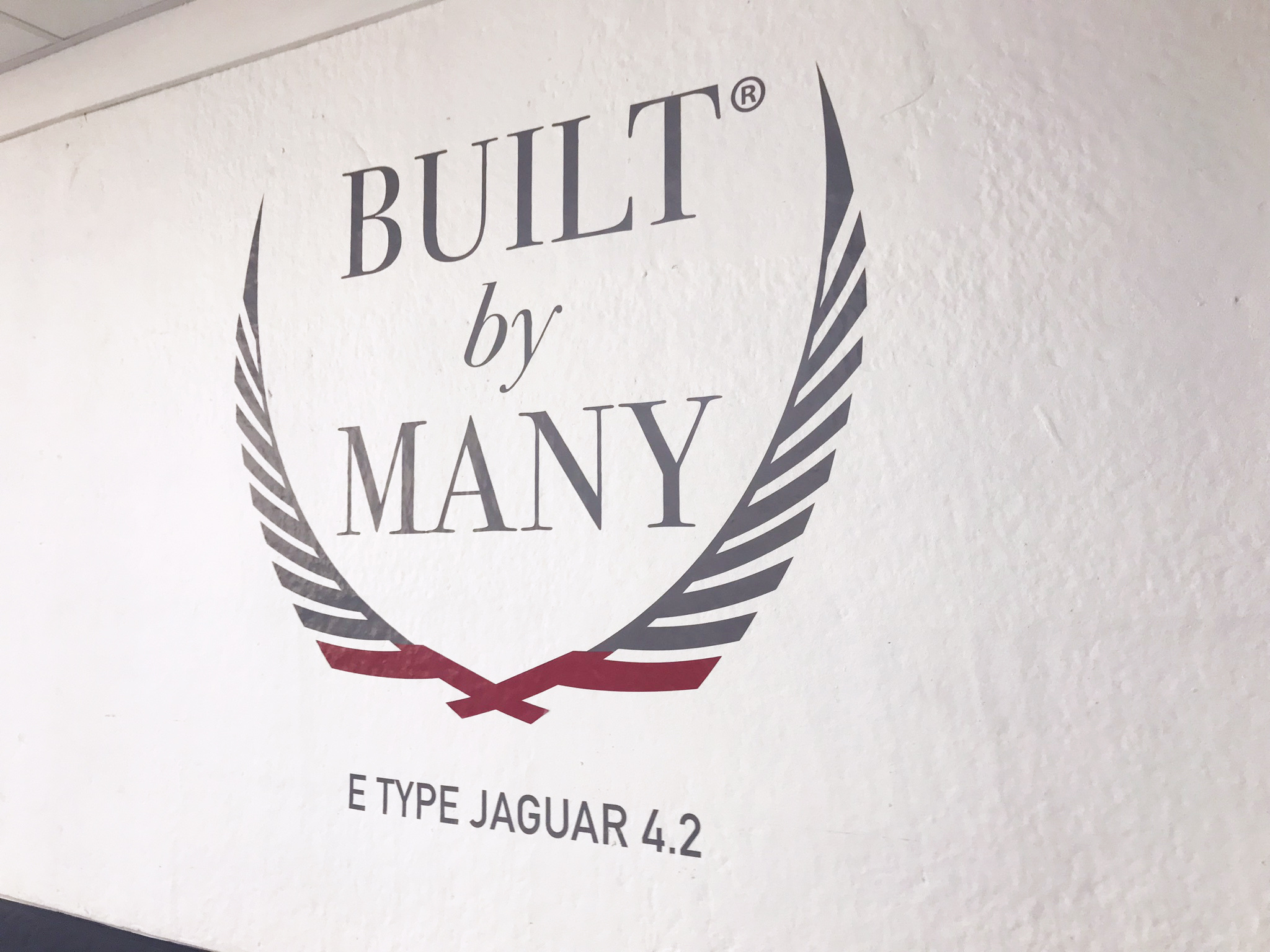 Built By Many logo on studio wall