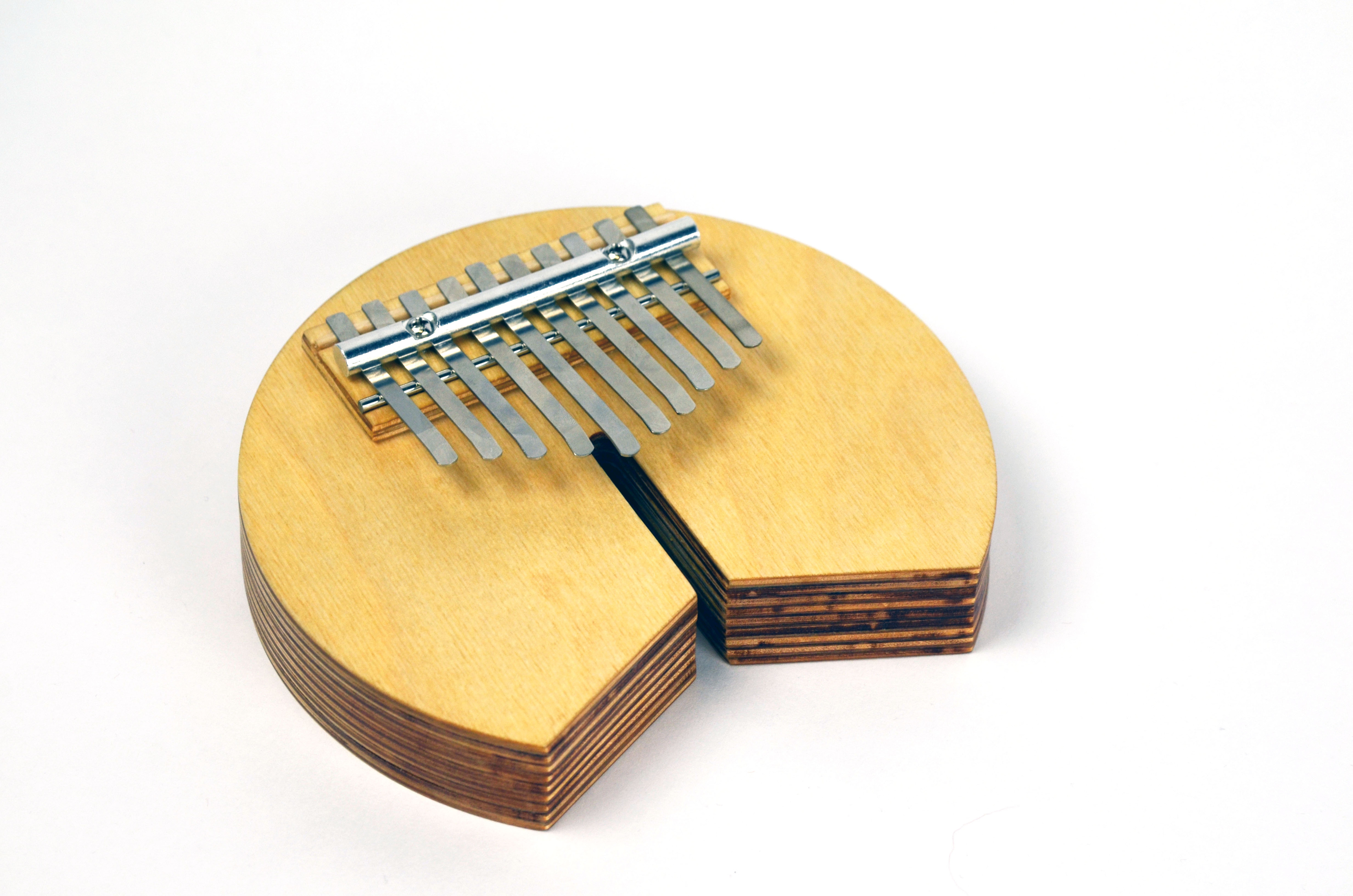 5c1bc0092f5 A Kalimba (the finger piano) in the shape of the letter C out of birch  plywood